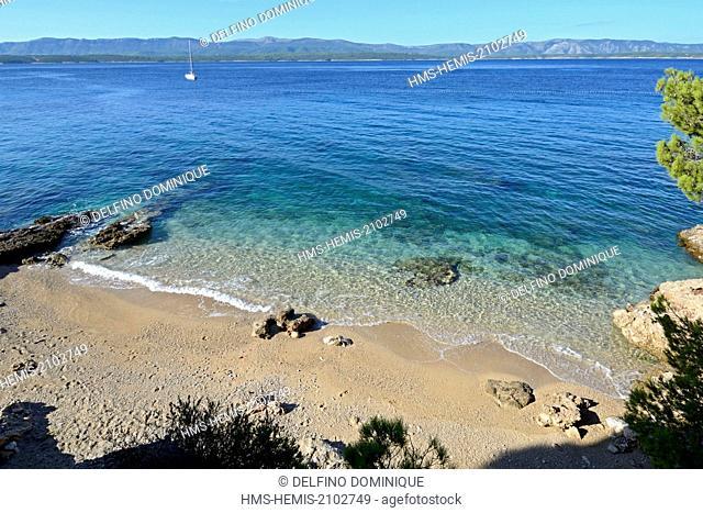 Croatia, Island Brac, cove beach before the arrival of the morning sunbathers