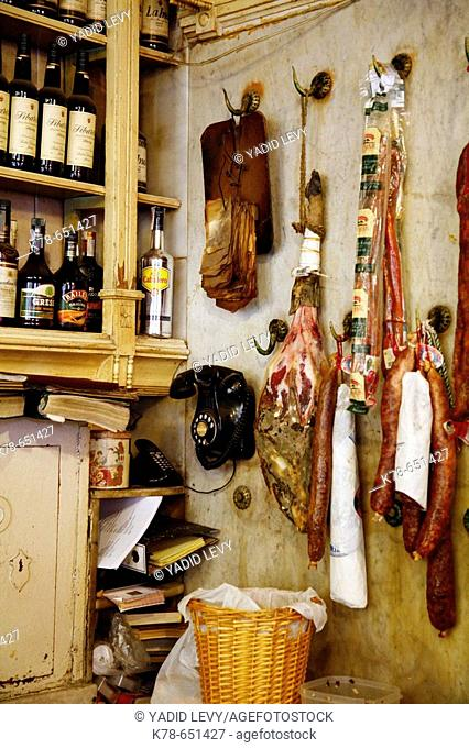 Ham and other pices of dried meat hangs on a kitchen wall at El Rinconcillo, Sevilles oldest tapas bar, Spain