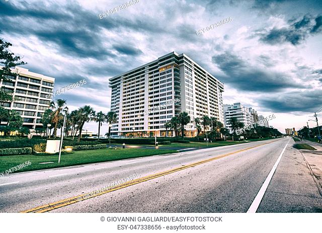 Boca Raton at sunset, Florida. Road,trees and buildings