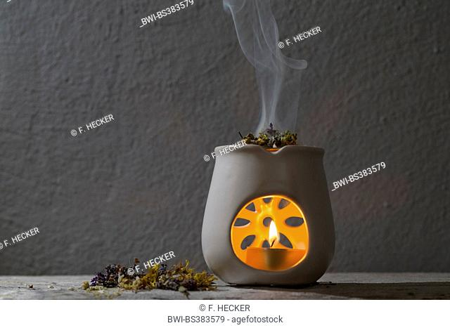 burning incense with herbs, aroma lamp