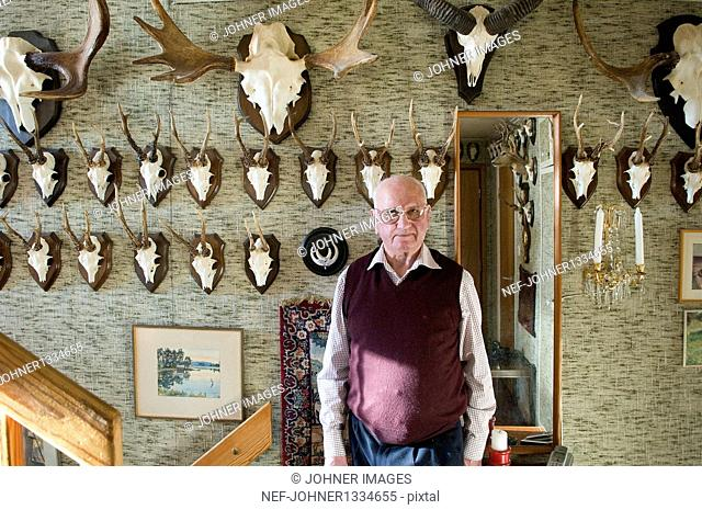 Portrait of senior posing with his hunting trophies