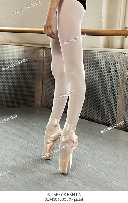 Legs and feet of ballerina en pointe