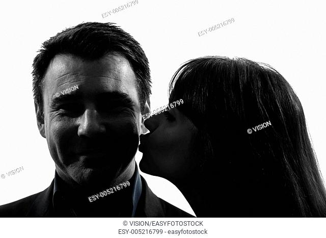 one caucasian couple woman kissing man in silhouette studio isolated on white background