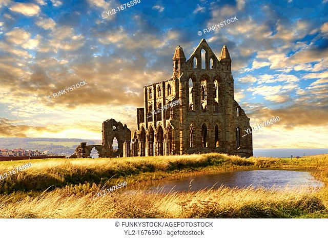 Medieval Gothic Whitby Abbey at sunset, Whitby, North Yrokshire, England