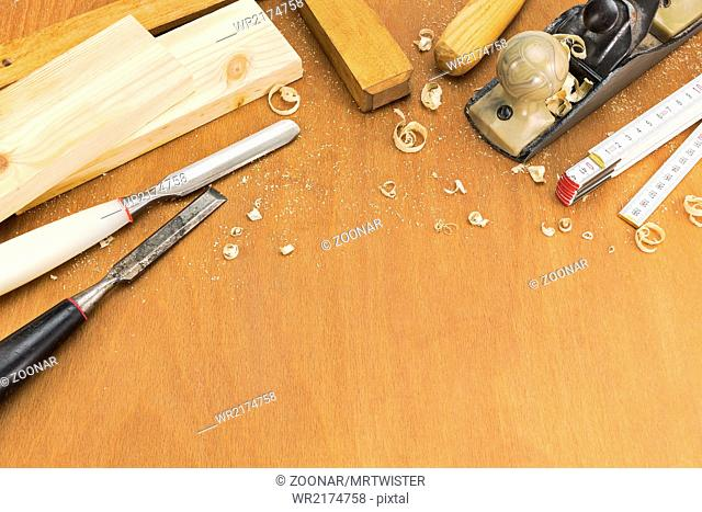 Chisels and plane with shavings on wood