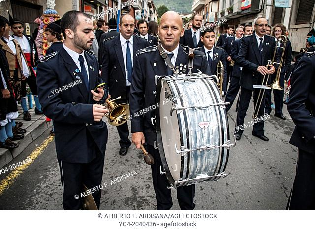 Band music. In the foreground a man with a drum, poses looking at camera during the parade of the celebrations of the Guide Llanes. Asturias. Spain