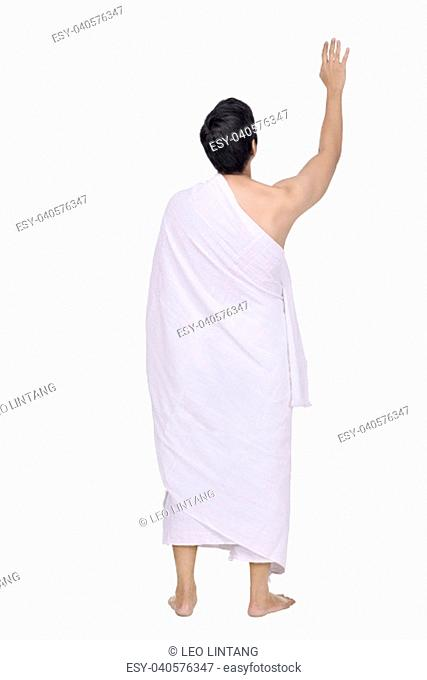 Rear view of asian muslim with ihram cloth standing isolated over white background