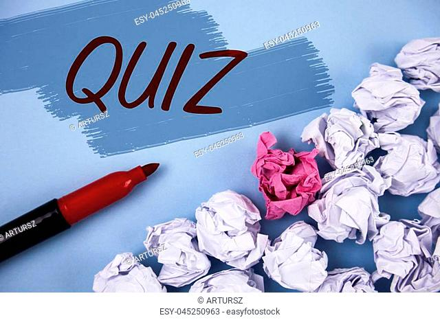 Text sign showing Quiz. Conceptual photo Short Tests Evaluation Examination to quantify your knowledge written Painted background Crumpled Paper Balls and...