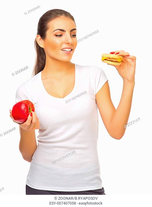 Young girl with red apple and hamburger isolated