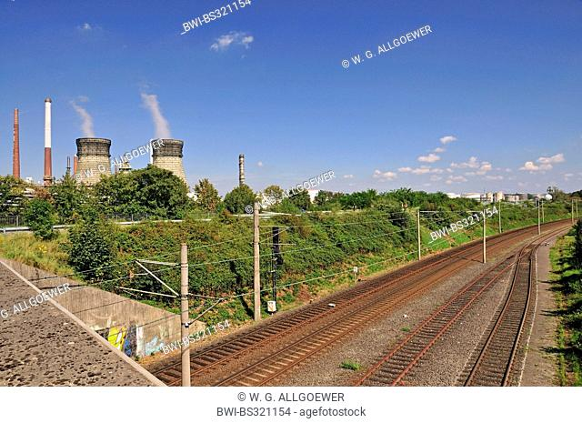 railtracks in front of the vent stacks and burner of an oil refinery, Germany, North Rhine-Westphalia, Godorf bei Wesseling