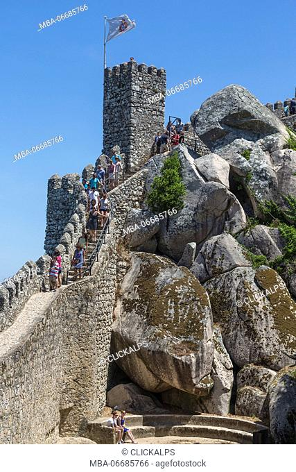 Tourists proceed towards the fortified stone tower of Castelo dos Mouros Sintra municipality Lisbon district Portugal Europe
