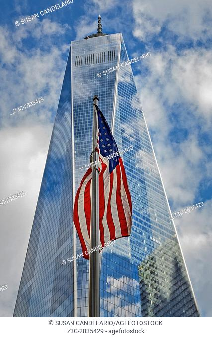 American Flag At World Trade Center WTC - The United States of America Flag sways in the wind with the Freedom Tower in the background.