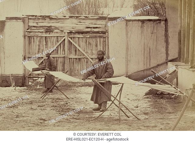 Using pre-industrial methods, two men prepare a warp for cotton cloth in Taskestan ca. 1870