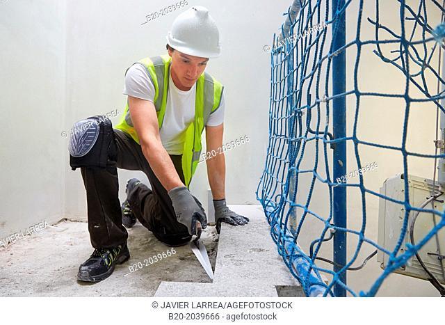 Bricklayer with a trowel. Construction of residential building. Donostia. San Sebastian. Gipuzkoa. Basque Country. Spain