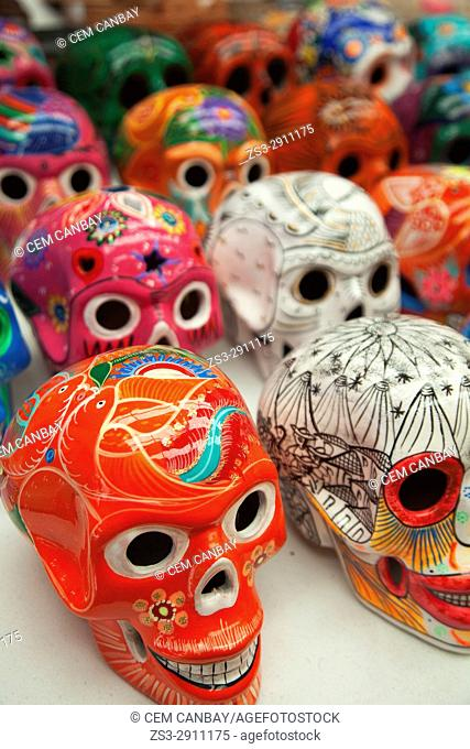Colorful skulls in the souvenir shop at the town center, Tulum, Quintana Roo, Riviera Maya, Mexico, Central America