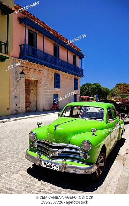 Old American car parked in front of the colonial building with balcony in Old Havana-Havana Vieja, La Habana, Cuba, Central America