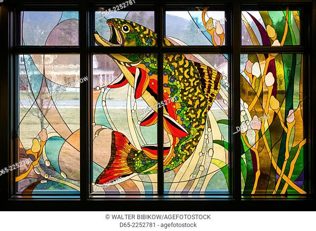 USA, Manchester Center, the Orvis store, hunting and fishing mecca, stained glass window of fish