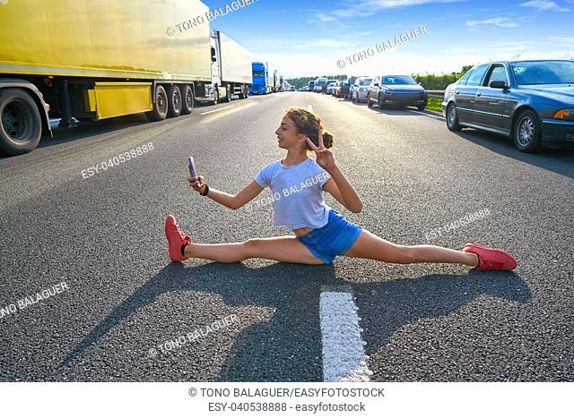 Split legs girl selfie photo in a traffic jam road having fun