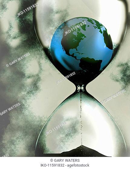 Globe disintegrating inside of hourglass