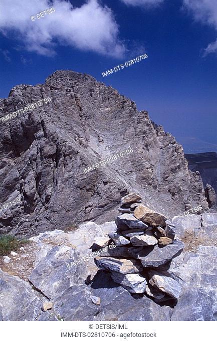 Cairn at Skala peak  Mytikas peak at the background , Mount Olympus, Macedonia Central, Greece