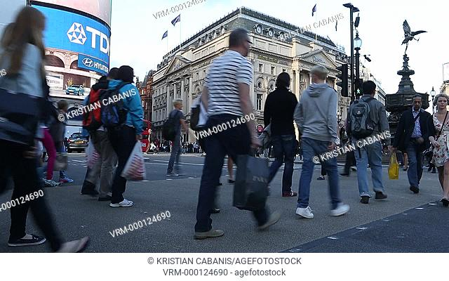 People crossing the street at Piccadilly Circus, London, England, Great Britain, Europe