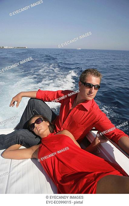 Young couple relaxing on a speedboat