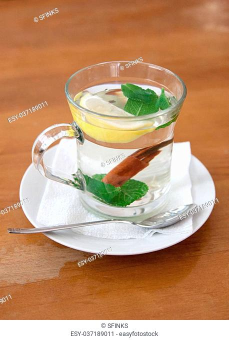 cup of mint tea with lemon and cinnamon