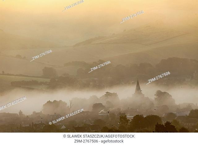 Misty autumn sunrise in Alfriston, South Downs National Park, East Sussex, England