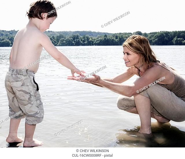 Mother encouraging Child