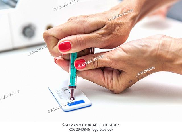 vet doing a blood test