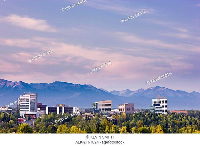 Panorama View Of Anchorage's Midtown Skyline With The Chugach Mountains In The Background, Southcentral Alaska, Autumn/N