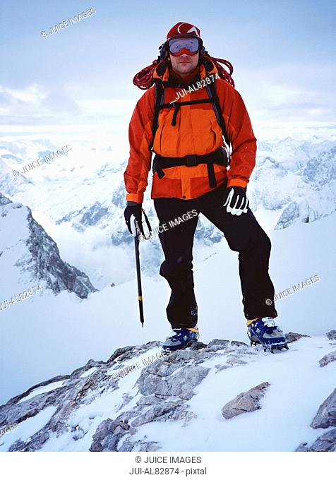 Male hiker standing on snowy mountain