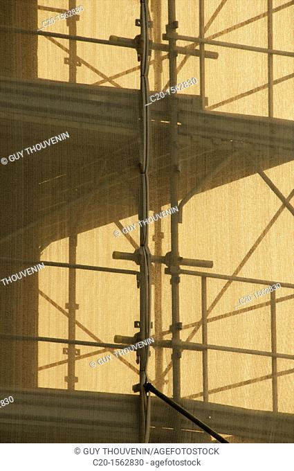 Scaffoldings and cover canvass over a building for restoration Sevilla Spain