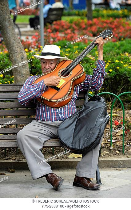 Man playing guitar,Medellin,Colombia,South America