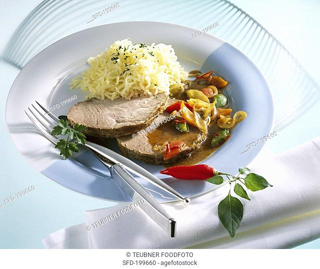 Spicy roast pork with potato snow and roasted vegetables