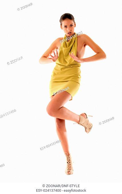 High fashion girl in green dress playing