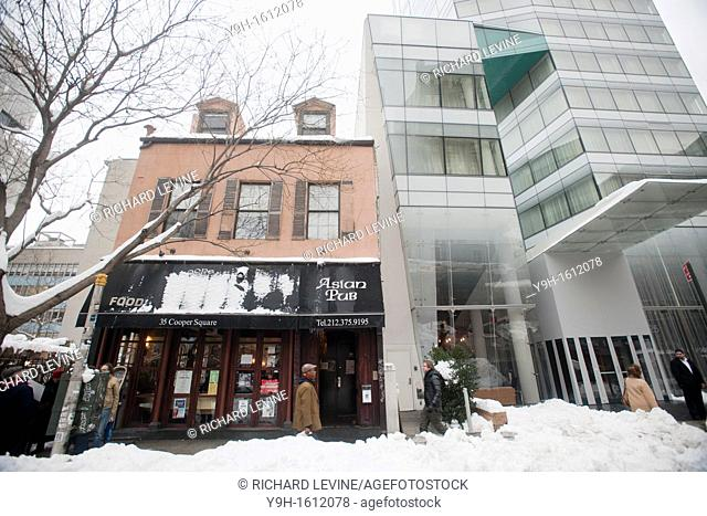 35 Cooper Square, left, and the Cooper Square Hotel are seen in New York Protesters gathered to show their support in saving the c 1825 building from being...