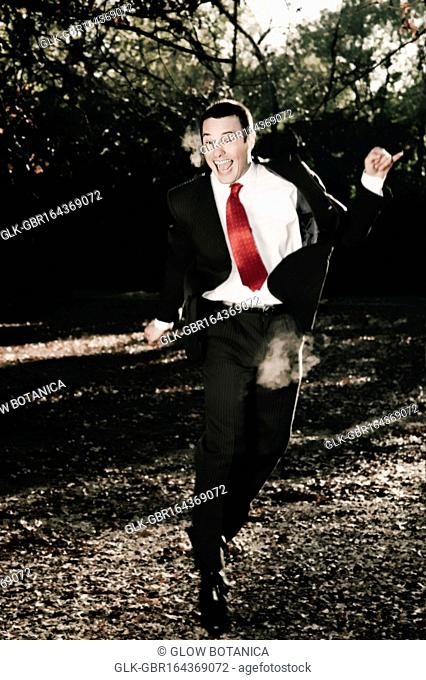 Businessman jumping in a park