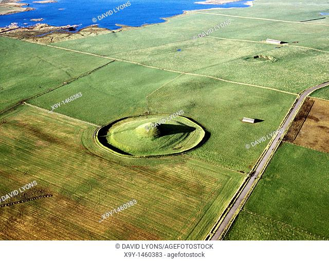 W  over Maes Howe prehistoric Neolithic chambered cairn and passage grave to Loch of Harray  Mainland island of Orkney, Scotland
