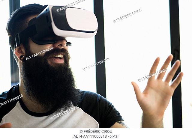 Man using virtual reality simulator