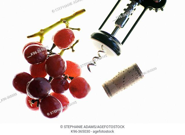 Wine opener, grapes and wine cork