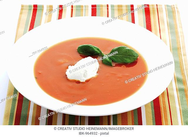 Tomato soup topped with cream dollop