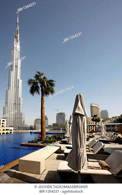 Burj Dubai, tallest building in the world, and the pool of the luxury hotel The Address, part of the Downtown Dubai, United Arab Emirates, Middle East