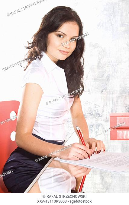 woman signing agreement