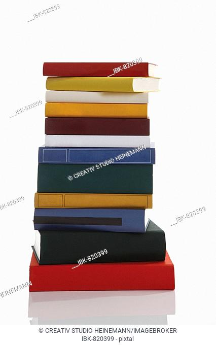 Stacked hardcover books, blank unprinted covers with no dust sleeve