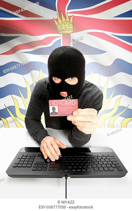 Hacker with ID card in hand and Canadian province flag on background - British Columbia