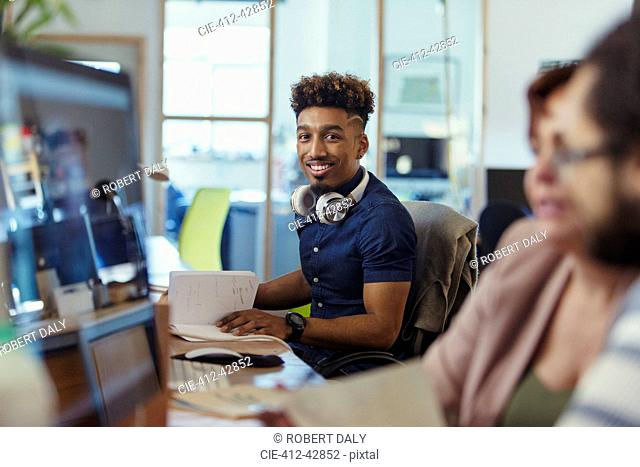Portrait smiling, confident creative businessman working in office