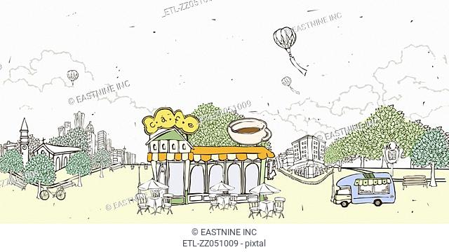Roadside cafe by buildings and hot air balloon flying against sky