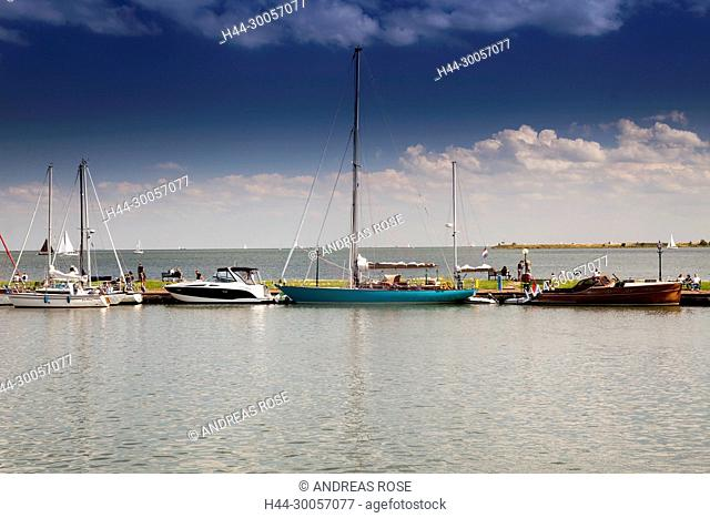 Boats at the harbor entrance of the small harbor of Volendam, Markermeer, Holland, Netherlands
