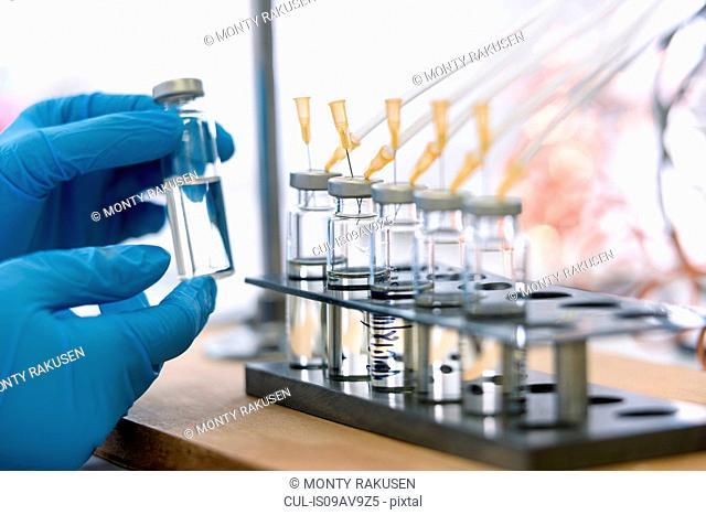 Laboratory worker testing oil samples